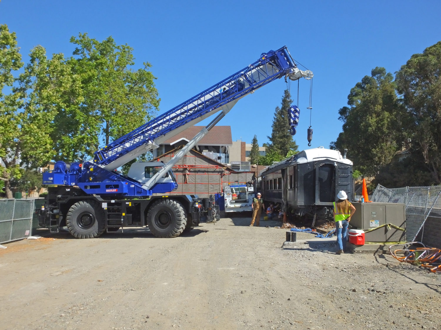 The 75 Ton Crane Prepares to Lift Front End of Car to Remove the 3-axle Truck
