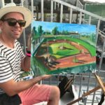 Artist paints Waterfront Park field during game