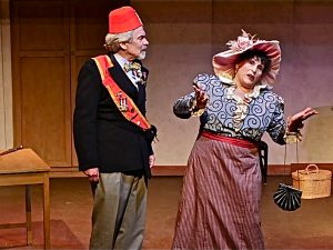 Old miser Horace Vandergelder (John Blytt) with matchmaker Dolly Levi (Jeanine Perasso)
