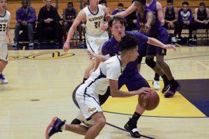 Jalen Shepard drives toward the basket against Cameron Martin