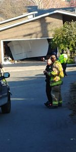 After rolling over the son, the truck then went through a garage door of a Kelly Avenue home